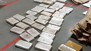 28 yaşındaki Rotterdamlı 82 kilo kokain ve 1,5 milyon avro nakit ile yakalandı